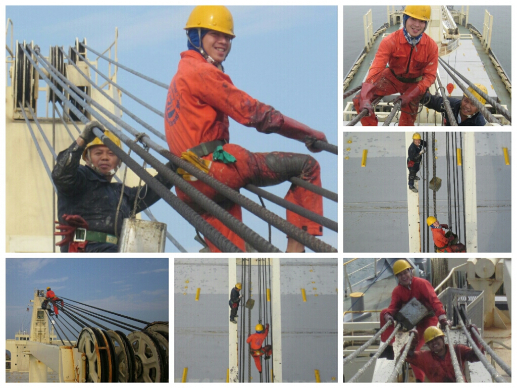 Sailors Working Aloft On Greasing Wire Crane One Of